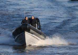 fast boat down thames daniel craig is back in james bond mode as he flies down