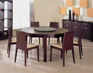 Round wood dining table is a rounded table with space for six chairs