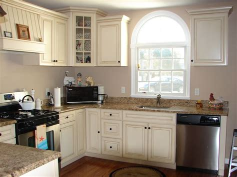 gray walls with distressed cabinets and pretty match to granite countertops