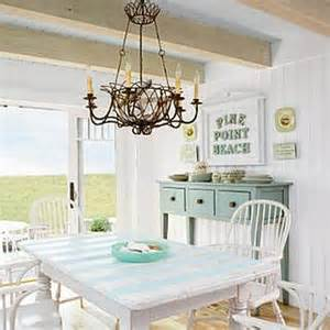 The lighting is what really stands out in this shabby chic kitchen by