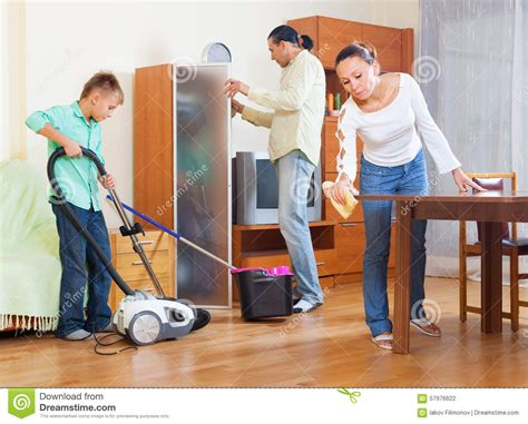 the room three family cleaning in living room stock photo image 57976622