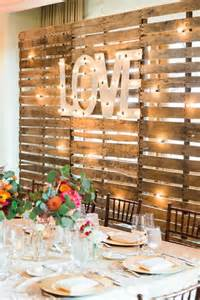 Rustic love wood pallets backdrop wedding party table