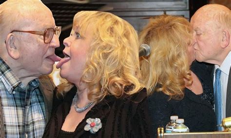 ed asner  sally struthers lock lips  tongues