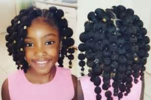 Puff balls hairstyle on your little girl thirstyroots girl hairstyle