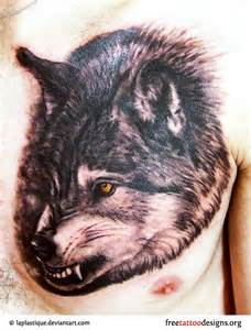 Angry wolf tattoo on a man s chest