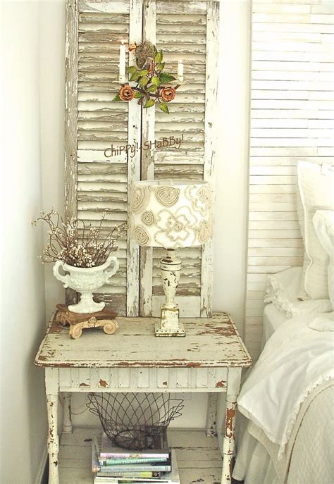 shabby chic chippy paint shutters and cute little urn