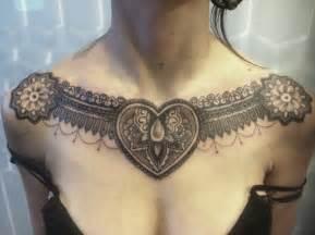 tribal feminine tattoo on chest