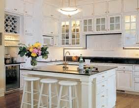white kitchen cabinets black granite built in wine rack traditional kitchen