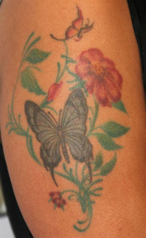 flower tattoo on upper arm marsha ambrosius tattoos flower tattoo on upper arm