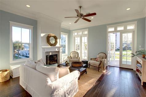 Sherwin Williams Black Bean traditional living room with ceiling fan amp crown molding