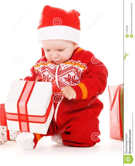santa helper baby with christmas gifts royalty free stock