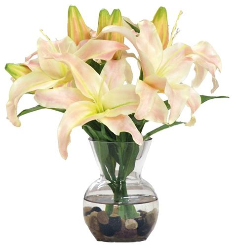 Artificial Lilies In Vase by Casablanca In Glass Vase With River Rocks