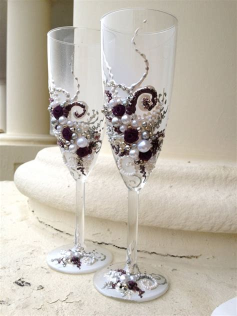 wedding chagne flutes in plum and hand