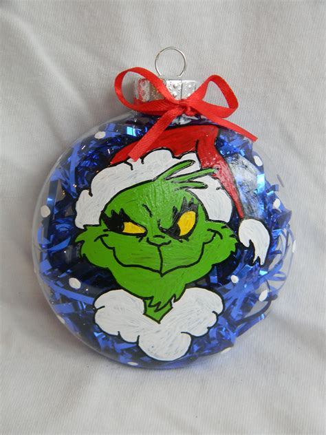 grinch inspired hand painted glass ornament