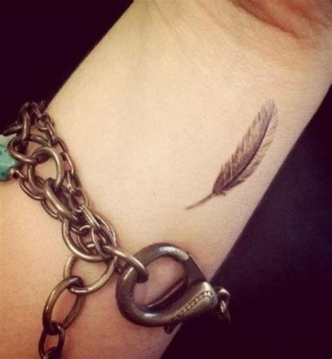 tiny feather tattoo wrist meaning design pictures