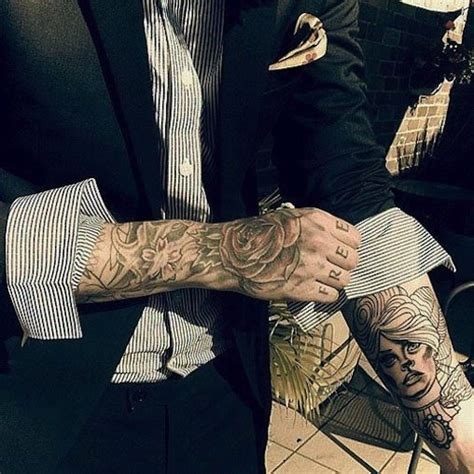 tattooed in suits rebel circus