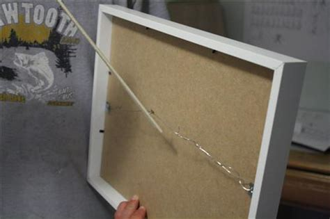 how to hang a picture frame how to hang ikea ribba frames in a and level grid