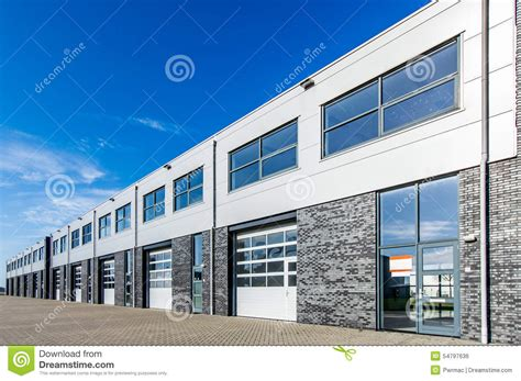 limitless industrial office building in modern industrial building with loading doors and blue sky