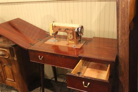 lot 240a vintage kenmore sewing machine in cabinet