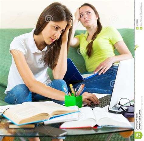 student couch two melancholy female students stock photo image 65930330