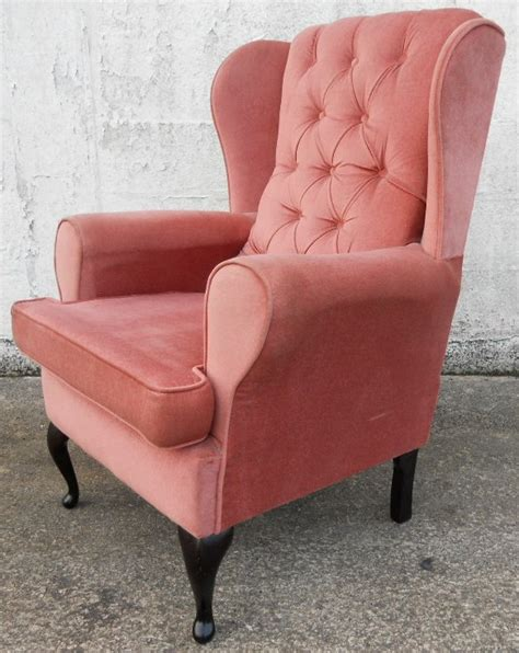 antique style wingback fireside armchair