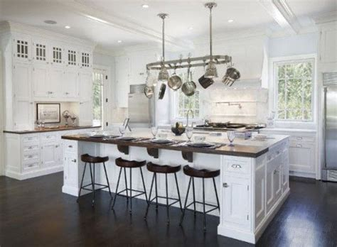 white kitchen islands with seating make seating on both sides and won t need a table