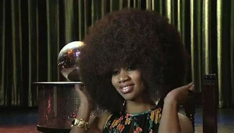 how to put the world s greatest hair buns with braids world s largest afro hair takes two days to wash
