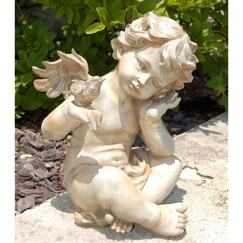 winged cherub with bird garden statues at hayneedle