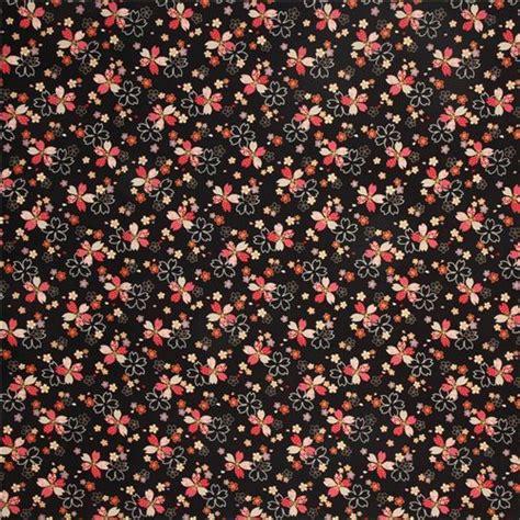 tessuti a fiori tessuto floreale nero fiori ciliegio motivi dorati kokka