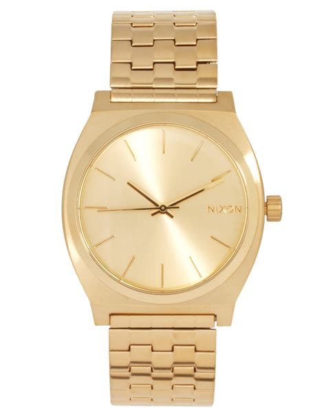 nixon gold stainless steel in gold lyst