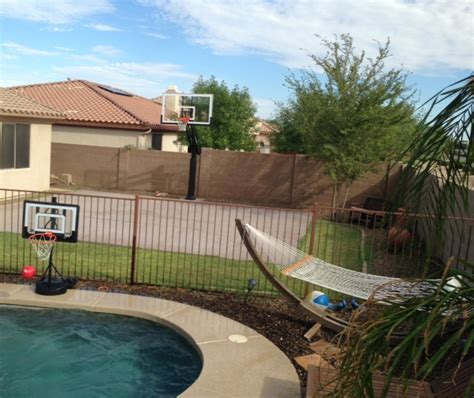 backyard pool and basketball court there is his backyard that has a minimal half court and a