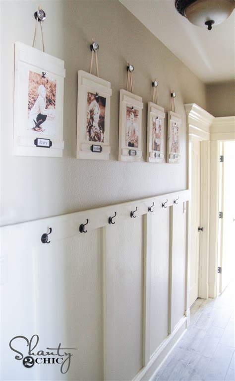 ideas on hanging pictures in hallway diy hanging frames with labels shanty 2 chic