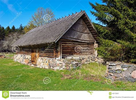old log barn stock photos image 16113943 old log barn with a thatched roof stock photo image
