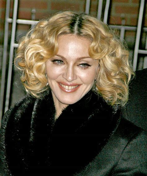 madonna medium curly casual hairstyle golden blonde hair