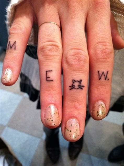cat finger tattoo meow letters cat on finger tattoomagz