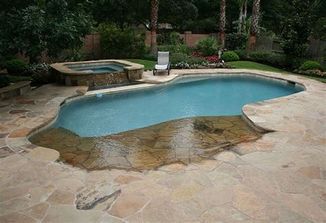 Backyard Swimming Pool With Beach Entry And Fire Pit Entry Swimming Pool Designs