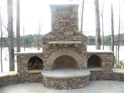outdoor fireplace built into retaining wall the