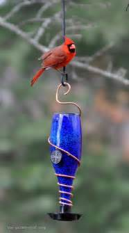 A Bird Feeder S Bird Gardens Diy Glass Bottle Bird Feeders
