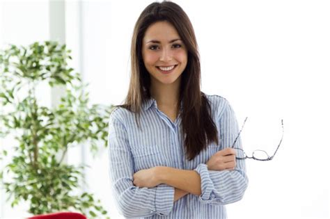youngest looking women business young woman looking at camera in the office