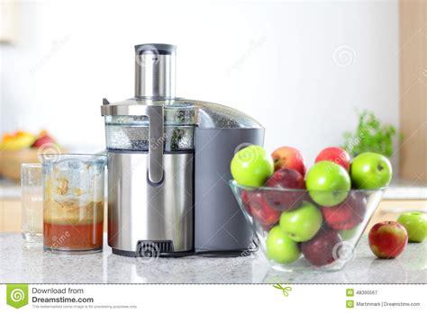 Detox Juice Makers by Apple Juice On Juicer Machine Juicing Stock Photo