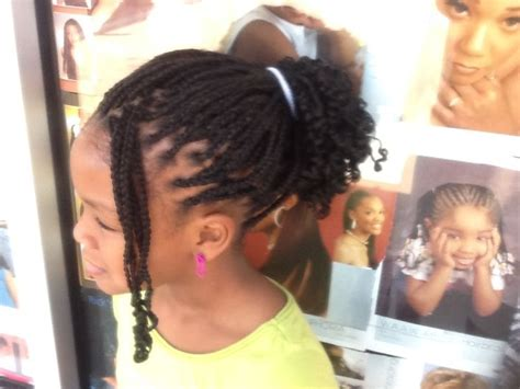 africans braiding hair and curled at the end braid individual with extension plus curl at the end