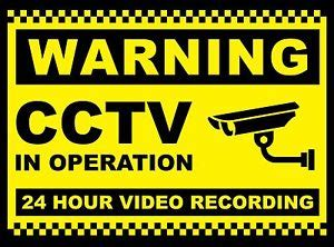 2x cctv in operation sign 24 hr recording security camera