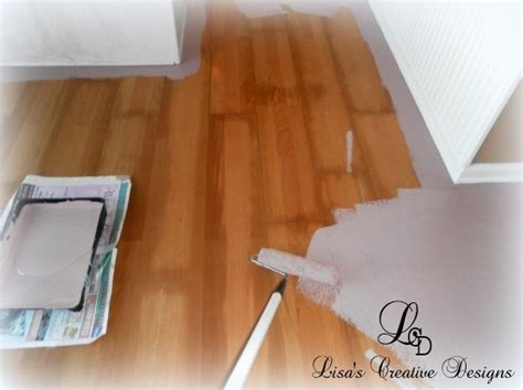 how to paint floors yes you can paint an old laminate floor lisa s creative