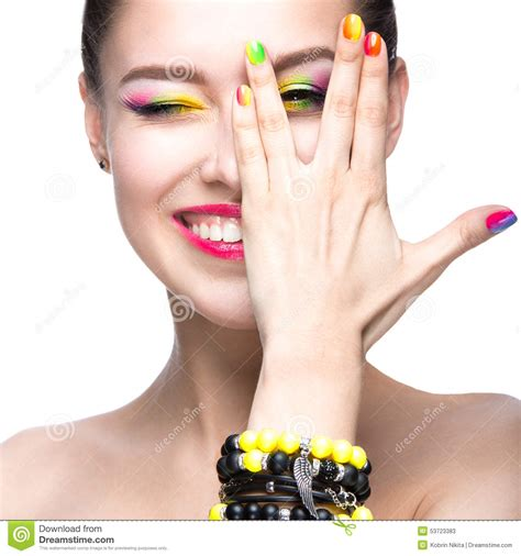 modele nail beautiful model with bright colored makeup and nail