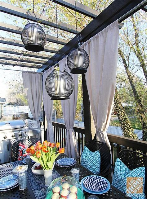 how to decorate a pergola deck decorating ideas pergola lights and cement planters