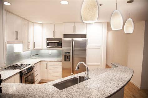 white kitchen cabinets honed salt and pepper granite