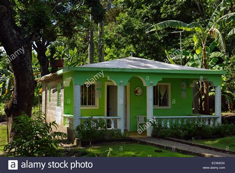 rural cinder block house painted green in