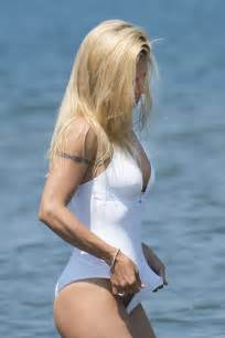 hunziker in white sexy swimsuit on the beach at forte dei marmi 10
