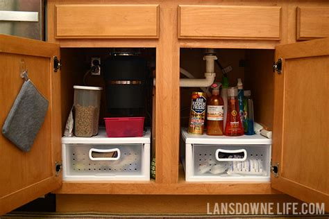 Small Bathroom Cabinet Storage Ideas by Organizing The Cabinet Under The Kitchen Sink Lansdowne Life