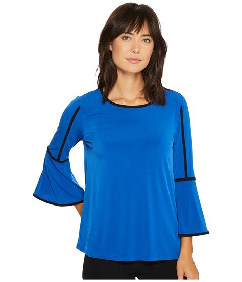 calvin klein piped bell sleeve top in celestial modesens